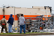 May 23, 2011- People stand in awe at the damage of The Home Depot in Joplin, Missouri after a Tornado came through the town on Sunday, May 22, 2011. Credit: David Welker / TurfImages.com.