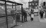 Man smoking an electronic vaporizer at a bus stop. His own mixture which he said didn't contain nicotine. Small battered looking town contained 2 shops selling pipes, headgear and skulls, Saltcoats. Ayrshire. Scotland. 2 April 2016