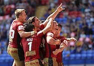 Tony Gigot of Catalans Dragons (right) celebrates with his team mates after scoring the third try against St Helens during the Ladbrokes Challenge Cup Semi Final match at the Macron Stadium Stadium, Bolton.<br /> <br /> Picture by Michael Sedgwick/Focus Images Ltd +44 7900 363072<br /> <br /> 05/08/2018
