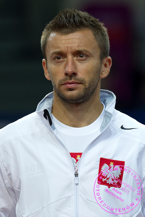 Michal Przysiezny of Poland while national anthem before the BNP Paribas Davis Cup 2013 between Poland and Australia at Torwar Hall in Warsaw on September 13, 2013.<br /> <br /> Poland, Warsaw, September 13, 2013<br /> <br /> Picture also available in RAW (NEF) or TIFF format on special request.<br /> <br /> For editorial use only. Any commercial or promotional use requires permission.<br /> <br /> Photo by © Adam Nurkiewicz / Mediasport