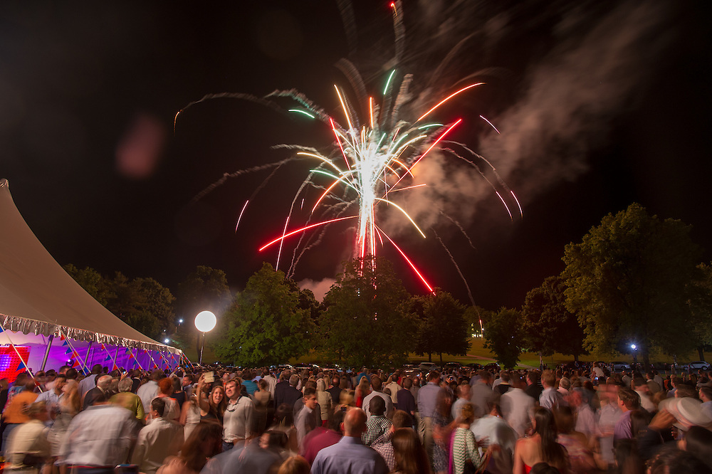 Crowd of people watching fireworks while a couple take a self-portrait in the crowd in Lewisburg, Pennsylvania, USA
