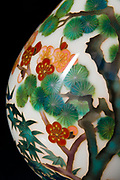 Detail of a cloisonne vase. Ando Cloisonne, Nagoya, Aichi Prefecture, Japan, February 26, 2018. Family-owned and run Ando Cloisonne was founded in the 1880s and is the only large manufacturer of cloisonne metalware left in Japan. The cloisonne enamelling process is technologically complex and a single work may feature over 50 colours.