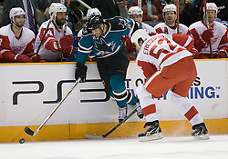 April 29, 2010; San Jose, CA, USA; San Jose Sharks center Manny Malhotra (27) chases after a loose puck with Detroit Red Wings defenseman Jonathan Ericsson (52) during the second period in game one of the western conference semifinals of the 2010 Stanley Cup Playoffs at HP Pavilion.  San Jose defeated Detroit 4-3. Mandatory Credit: Jason O. Watson / US PRESSWIRE