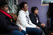 Qiana Holmes Abanukam, Marilyn Ruffin, and Teresita Torrence look on during their book club meeting in Sun Prairie, Wisconsin, Friday, Oct. 26, 2018.