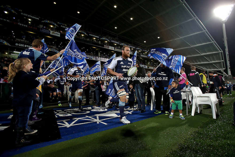 Luke Braid of the Blues leads his team onto the field. Super Rugby rugby union match, Blues v Sharks at North Harbour Stadium, Auckland, New Zealand. Friday 23rd May 2014. Photo: Anthony Au-Yeung / photosport.co.nz