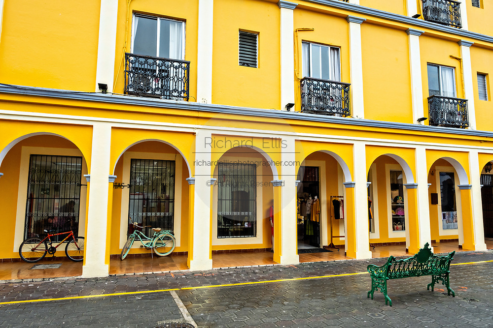 Brightly painted colonnaded style Hotel Posada Doña Lala along the Venustiano Carranza pedestrian walkway in Tlacotalpan, Veracruz, Mexico. The tiny town is painted a riot of colors and features well preserved colonial Caribbean architectural style dating from the mid-16th-century.