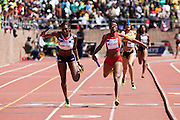 Francena McCorory with the USA Red team edges Perri Shakes-Drayton of Great Britain by a tenth of a second to win the USA vs. the World Women's 4x400 at the 119th Penn Relays on Saturday, April 27, 2013 in Philadelphia, PA.
