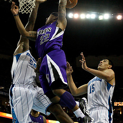 February 6, 2012; New Orleans, LA, USA; Sacramento Kings point guard Isaiah Thomas (22) passes as New Orleans Hornets center Emeka Okafor (50) and power forward Gustavo Ayon (15) defend during the second half of a game at the New Orleans Arena. The Kings defeated the Hornets 100-92.  Mandatory Credit: Derick E. Hingle-US PRESSWIRE