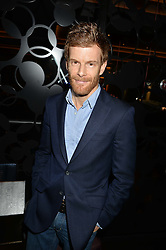 TOM AIKENS at a party to celebrate the opening of 'M' a new restaurant & bar at 2 Threadneedle Walk, 60 Threadneedle Street, City of London on 12th November 2014.