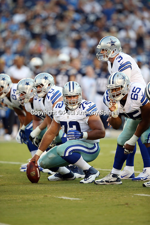 Dallas Cowboys center Travis Frederick (72) gets set to snap the ball during the 2015 NFL preseason football game against the San Diego Chargers on Thursday, Aug. 13, 2015 in San Diego. The Chargers won the game 17-7. (©Paul Anthony Spinelli)