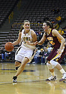 February 18, 2010: Iowa forward Kelsey Cermak (22) drives around Minnesota forward Jackie Voigt (45) during the first half of the NCAA women's basketball game at Carver-Hawkeye Arena in Iowa City, Iowa on February 18, 2010. Iowa defeated Minnesota 75-54.