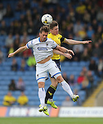 AFC Wimbledon midfielder Dannie Bulman (4) leaps for a header during the Sky Bet League 2 match between Oxford United and AFC Wimbledon at the Kassam Stadium, Oxford, England on 10 October 2015.