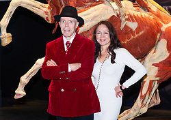 October 4, 2018 - London, London, United Kingdom - Body Worlds museum. ..Dr Gunther von Hagens and his co-director and wife Dr Angelina Whalley pose near a plastinated horse and human body of during the call...Launch of Gunther von Hagens' Body Worlds museum which is opening at a permanent museum site at The London Pavilion....Created by Dr Gunther von Hagens and his co-director and wife Dr Angelina Whalley, the museum represents a chance to make the most detailed ever journey around the human body, and features real bodies and body parts donated to be preserved by Dr von Hagens' patented 'plastination' technique, which replaces fat and water in cells with complex synthetics. (Credit Image: © Gustavo Valiente/i-Images via ZUMA Press)