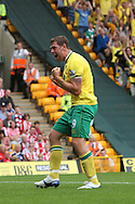 Grant Holt of Norwich celebrates Ritchie De Laet of Norwich opening the scoring during the Barclays Premier League match at Carrow Road Stadium, Norwich, Norfolk...Picture by Paul Chesterton/Focus Images Ltd.  07904 640267.21/8/11