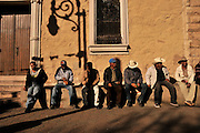 Men sit at a plaza in Nogales, Sonora, Mexico, across the border from Nogales, Arizona, USA.