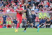 York City forward Vadaine Oliverbattles with Mansfield Town defender Krystian Pearce during the Sky Bet League 2 match between York City and Mansfield Town at Bootham Crescent, York, England on 29 August 2015. Photo by Simon Davies.