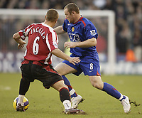 Photo: Aidan Ellis.<br /> Sheffield United v Manchester United. The Barclays Premiership. 18/11/2006.<br /> Manchester's Wayne Rooney goes past Sheffield's Phil Jagielka