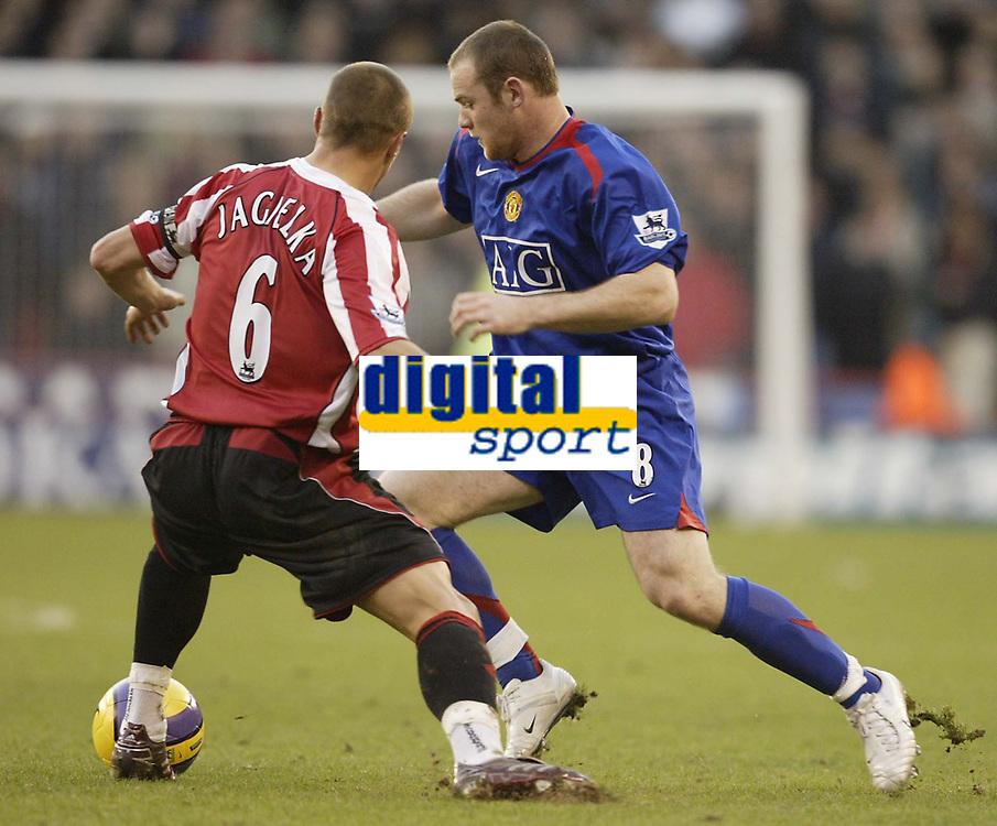 Photo: Aidan Ellis.<br /> Sheffield United v Manchester United. The Barclays Premiership. 18/11/2006.<br /> Manchester's Wayne Rooney goes past Sheffield's Phil Jagielka