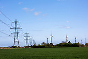Electrical pylons running alongside the Little Cheyne Court Wind Farm on Romney Marsh, Kent, United Kingdom. The wind farm has a nameplate capacity of 59.8 MW.<br /> (photo by Andrew Aitchison / In pictures via Getty Images)