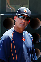 OAKLAND, CA - MAY 01: A.J. Hinch #14 of the Houston Astros stands in the dugout before the game against the Oakland Athletics at the Oakland Coliseum on May 1, 2016 in Oakland, California. The Houston Astros defeated the Oakland Athletics 2-1. (Photo by Jason O. Watson/Getty Images) *** Local Caption *** A.J. Hinch