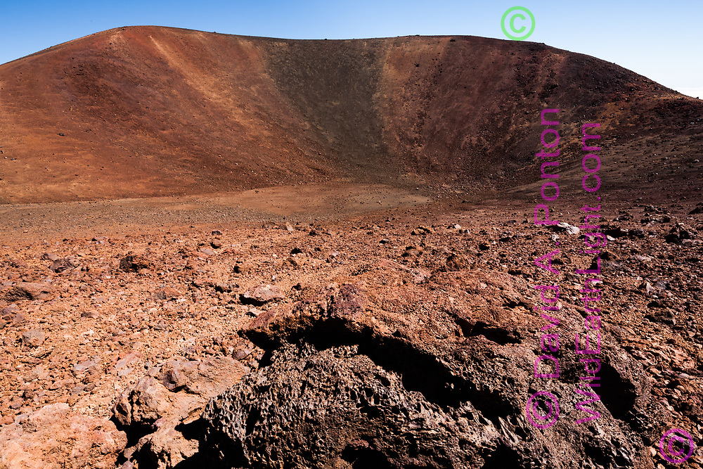 Igneous rock on the inner slope  of a small volcanic crater at the summit of Mauna Kea. Summit is at the upper left. Big Island, Hawaii, © 2010 David A. Ponton