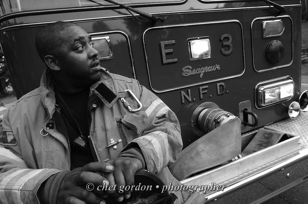 Newburgh firefighter Jason Blackwell rests on the bumper of an Engine after firefighters responded to a call of a transformer fire in Newburgh, NY on Thursday, July 21, 2011.  © www.chetgordon.com/blog