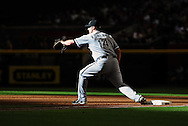 Jun. 18 2011; Phoenix, AZ, USA; Chicago White Sox first basemen Paul Konerko (14) warms up at first base prior to the second inning against the Arizona Diamondbacks at Chase Field. Mandatory Credit: Jennifer Stewart-US PRESSWIRE..