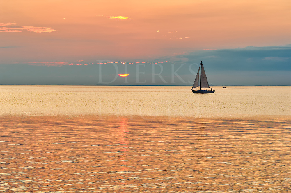 Sailboat in the sunset coming into Sister Bay in Door County, Wisconsin.