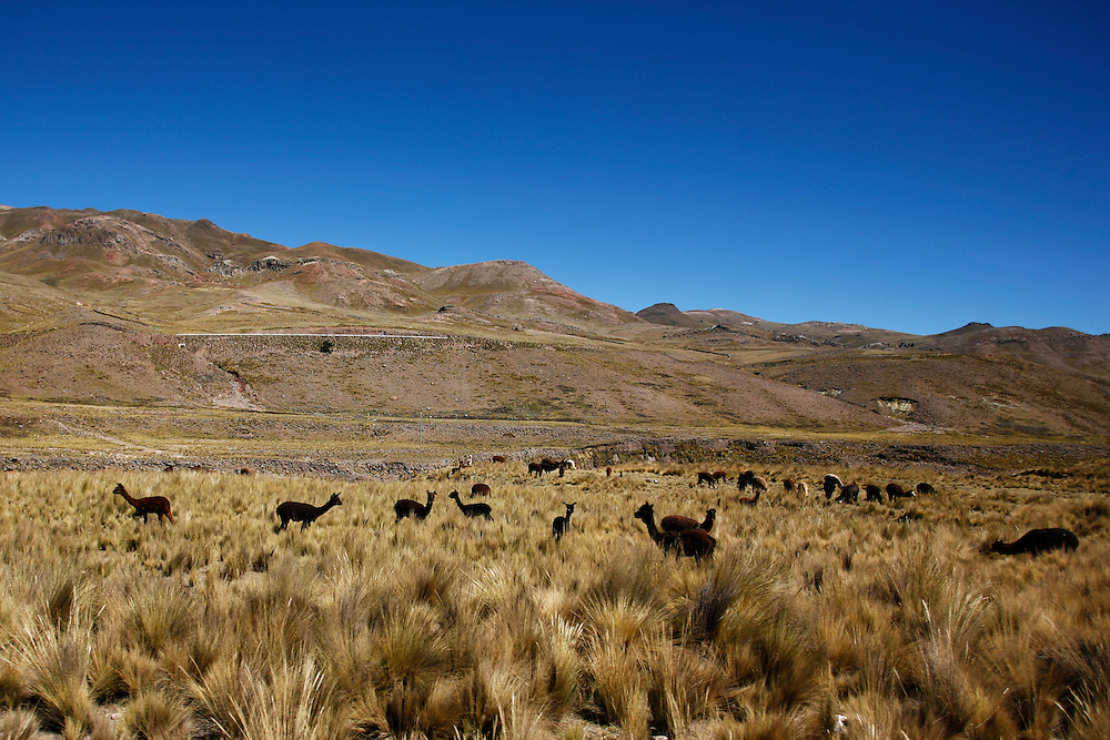A view of the journey between Rumichaca and Huancavelica, Peru, from a bus traveling over an unpaved road through the South-Central Sierra of the Andes.