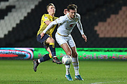 Coventry City midfielder Jamie Allen (8) battles for possession  with Milton Keynes Dons midfielder Alex Gilbey (8) during the EFL Trophy match between Milton Keynes Dons and Coventry City at Stadium:MK, Milton Keynes, England on 3 December 2019.
