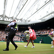 LONDON, ENGLAND - JULY 15:  Garbine Muguruza of Spain and Venus Williams of The United States enter Center Court for the Ladies Singles Final match in the Wimbledon Lawn Tennis Championships at the All England Lawn Tennis and Croquet Club at Wimbledon on July 15, 2017 in London, England. (Photo by Tim Clayton/Corbis via Getty Images)