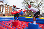 Ohio University students Justin Wyatt and Randy Stites battle in a game of joust as  part of a celebration on South Beach organized by the University Program Council April 24, 2014.  Photo by Jonathan Adams / Ohio University