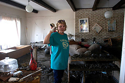 08 Sept 2005.  New Orleans, Louisiana. Hurricane Katrina aftermath. <br /> Venetian Isles in East New Orleans, where the tidal surge washed over the land and devastated homes and property.<br /> Peggy Lala surveys the damage to her mud filled flood ravaged home.<br /> Photo; ©Charlie Varley/varleypix.com