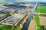 Nederland, Flevoland, Almere,  10-10-2014; Almere-Buiten, Regenboogbuurt met aan het water van de Lage Vaart de Rooie Donders van architect Liesbeth van der Pol.<br /> Residential distict 'Rainbow Area'. Next to the canal Lage Vaart some red buildings called Rooie Donders (red devils) by architect Liesbeth van der Pol.<br /> luchtfoto (toeslag op standaard tarieven); <br /> aerial photo (additional fee required);<br /> copyright foto/photo Siebe Swart.