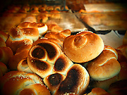 Freshly baked braided Challah loafs and rolls in a bakery shop window. Israel