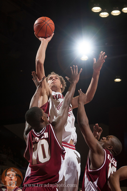 November 25, 2006; Stanford, CA, USA; Stanford Cardinal center Robin Lopez (42) shoots the basketball against Denver Pioneers guard Antonio Porch (10) during the game at Maples Pavilion. The Cardinal defeated the Pioneers 82-39.