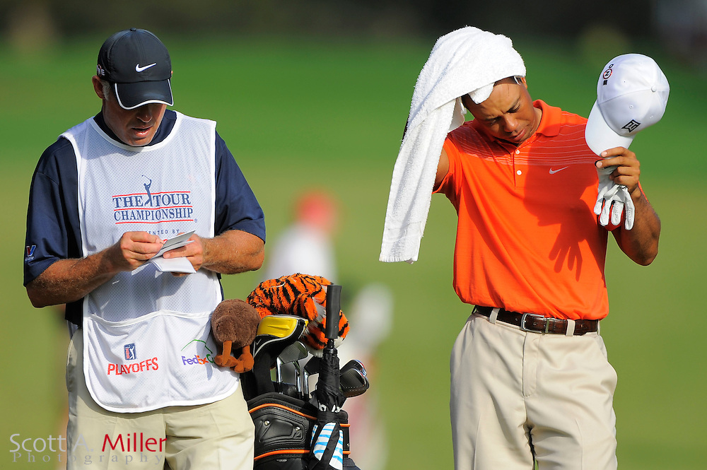 Lucas Glover (USA) and his caddie Steve Williams on the 16th hole during the second round of the PGA Tour Championship at East Lake Golf Club on Sept. 25, 2009 in Decatur, Ga.     ..©2009 Scott A. Miller