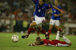 BELGRADE, SERBIA & MONTENEGRO - Wednesday, August 20, 2003: Wales' Robbie Savage is knocked to the ground in the penalty area in injury time by Serbia & Montenegro's Goran Gavrancic during the UEFA European Championship qualifying match at the Red Star Stadium. (Pic by David Rawcliffe/Propaganda)