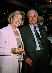 SUSAN, VISCOUNTESS HEREFORD and SIR JAMES CAYZER Bt. at a party in London on 5th June 1997.LYZ 11