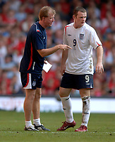 Photo: Henry Browne.<br /> Wales v England. FIFA World Cup Qualifying match.<br /> 03/09/2005.<br /> Wayne Rooney gets some direction from Steve McClaren as he struggles as a lone striker.