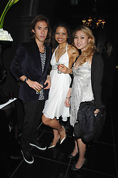 Left to right, EDWARD TANG, EMMA McQUISTON and YUKI OSHIMA-WILPON at the grand opening of the Amika nightclub, 65 High Street Kensington, London on 28th February 2007.<br />