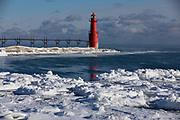 Lighthouse on Lake Michigan in Algoma, Wisconsin on a cold winter day.