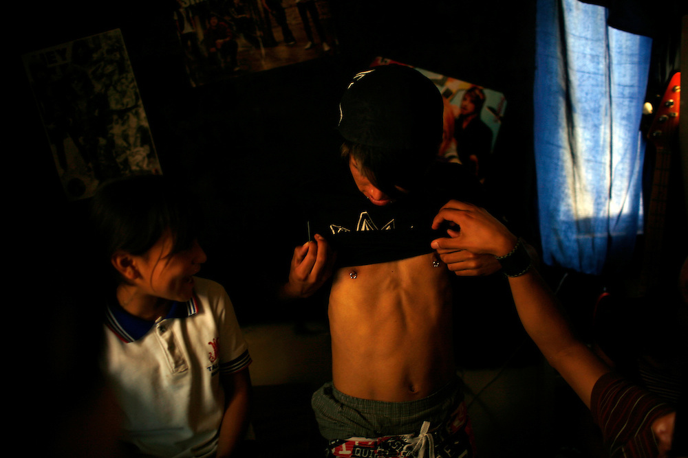 Juan Miguel, 16, shows of his piercing, in the Diaz Ordaz colonia in Ciudad Juarez, Chihuahua Mexico on April 28, 2010.