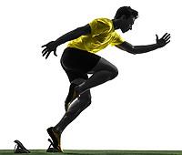 one  man young sprinter runner in starting blocks silhouette studio on white background