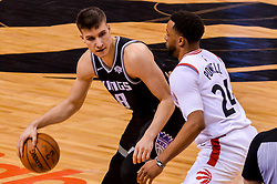 January 22, 2019 - Toronto, Ontario, Canada - Bogdan Bogdanovic #8 of the Sacramento Kings with the ball against Norman Powell #24 of the Toronto Raptors during the Toronto Raptors vs Sacramento Kings  NBA regular season game at Scotiabank Arena on January 22, 2018 in Toronto, Canada (Toronto Raptors win 120-105) (Credit Image: © Anatoliy Cherkasov/NurPhoto via ZUMA Press)