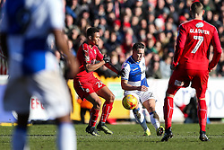 Billy Bodin of Bristol Rovers is challenged by Jermaine Hylton of Swindon Town - Rogan Thomson/JMP - 28/01/2017 - FOOTBALL - Memorial Stadium - Bristol, England - Bristol Rovers v Swindon Town - Sky Bet League One.