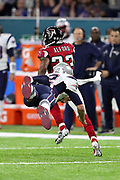 New England Patriots quarterback Tom Brady (12) dives in vain while trying to make a tackle on Atlanta Falcons cornerback Robert Alford (23) as he returns an interception of a Brady pass 82 yards for a pick six and a 21-0 second quarter Falcons lead during the Super Bowl LI football game against the New England Patriots on Sunday, Feb. 5, 2017 in Houston. The Patriots won the game 34-28 in overtime. (©Paul Anthony Spinelli)