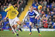 Ipswich Town forward Freddie Sears (20) tries to get on the end of a through ball but it's cleared by Leeds United defender, Kyle Bartley (5) during the EFL Sky Bet Championship match between Ipswich Town and Leeds United at Portman Road, Ipswich, England on 18 February 2017. Photo by Nigel Cole.