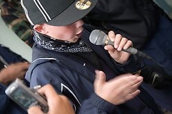 Teenager performing during a community day promoting learning and diversity,