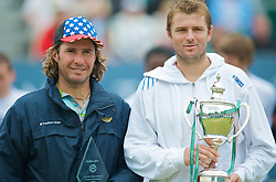 LIVERPOOL, ENGLAND - Saturday, June 20, 2009: Champion Mardy Fish (USA) with the Boodles & Dunthorpe Trophy and runner-up Vince Spadea (USA) after the Men's Final on Day Four of the Tradition ICAP Liverpool International Tennis Tournament 2009 at Calderstones Park. (Pic by David Rawcliffe/Propaganda)